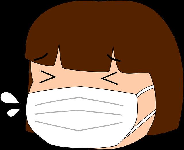 咳をしている人